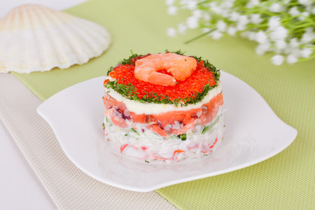 salad with seafood, shrimps and red caviar photo
