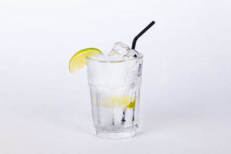 cola cocktail with lemon and ice on a white background photo