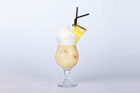 pina colada with pineapple a white background photo