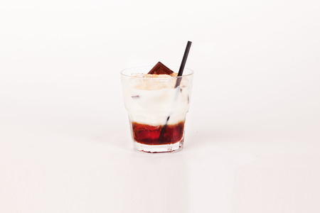 mud slide: chocolate alcoholic cocktail in a glass on a white background