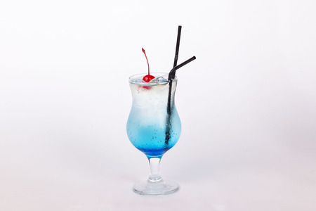 Blue Lagoon cocktail with a cherry photo