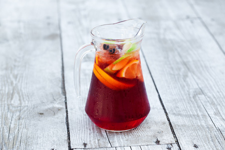 sangria with red wine in a jug on the boards photo