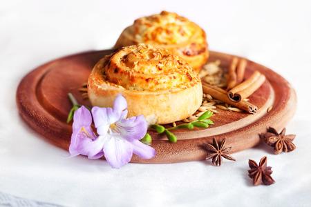 Vitushka bun with cinnamon on board with flower photo