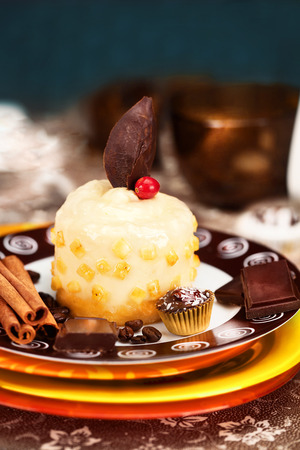 trifles: banana parfait with chocolate decoration on a plate in still life