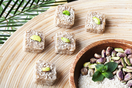 raw food sweets with pistachios, coconut in a still life photo