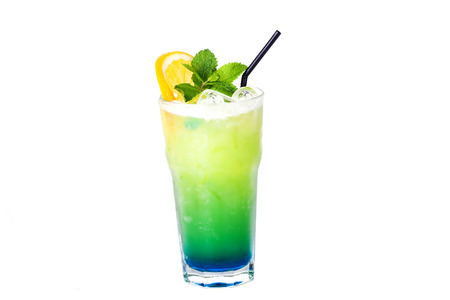 blue green cocktail with orange and mint on a white background photo