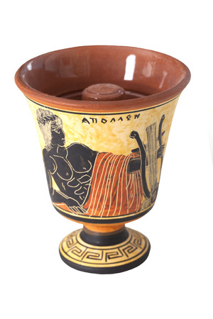showpiece: Pythagoras cup with a picture of Apollo on a white background Stock Photo