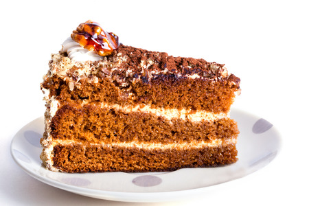 Honey cake with walnuts on a white background photo