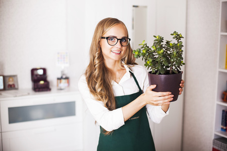 cute girl with a money Tree is at home photo