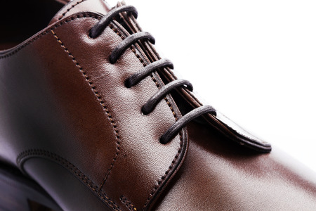 mens leather shoes closeup on white background photo