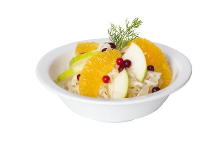 cabbage salad with apples, oranges and cranberries on a white background photo