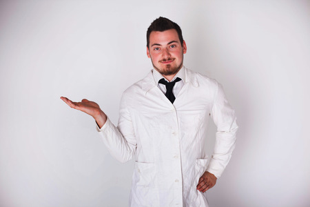 a man in a white robe holding space photo