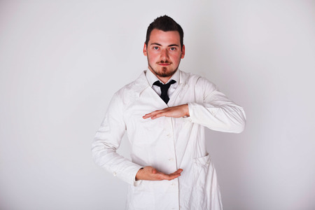 doctor holding gift: a man in a white robe holding space Stock Photo