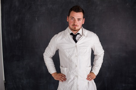 a white robe: a man in a white robe holding space Stock Photo