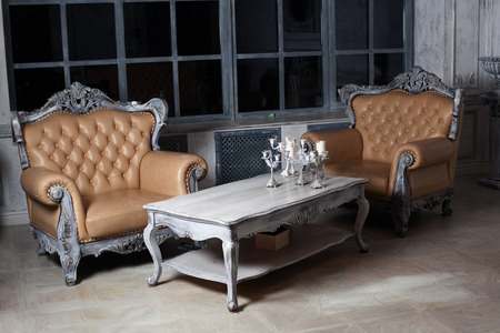 two chairs and a table in the style of furniture garnirur borokko in a beautiful luxurious interior photo