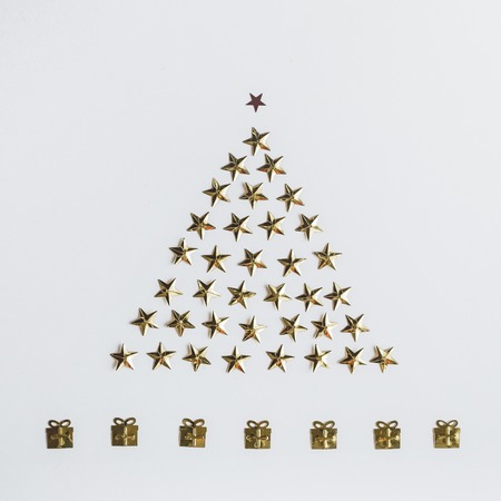 New Years composition. Christmas tree of spangles in the form of stars. Beautiful greeting card. Top view Stock Photo