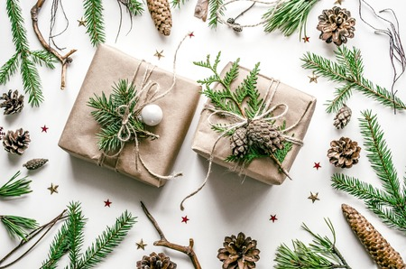 Christmas composition for the preparation for the New Year. Beautifully packaged gifts in Eco-style. Top view