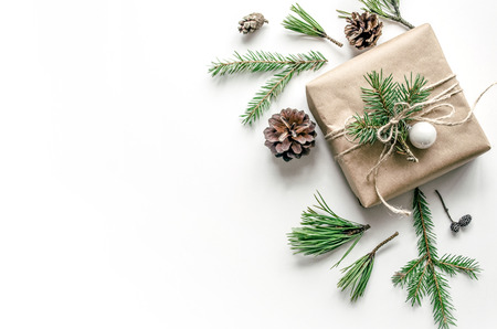 Christmas composition with a gift on a white background. Eco-style. Christmas background for presentation of work or text. Copy space. Top view Stock fotó
