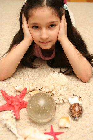 cockleshells: The girl, sea cockleshells and a starfish