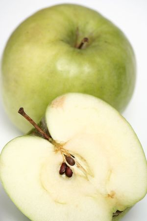 useful: Two green apples on a white background