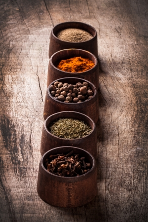 Various spices on wooden background 版權商用圖片