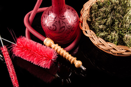 Red hookah on a black background photo