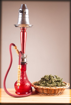 bloat: Red hookah on a wooden table
