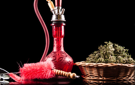 bloat: Red hookah on a black background Stock Photo