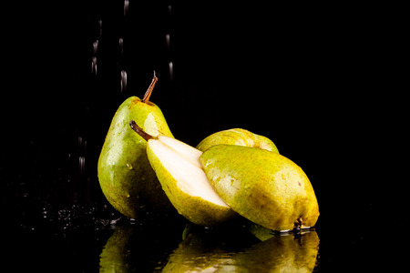 flavorful: Juicy flavorful pears on a black background