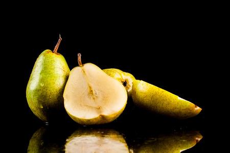 herbivore natural: Juicy flavorful pears on a black background