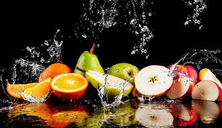 Pears, apples, orange  fruits and Splashing water Standard-Bild