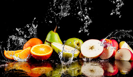 Pears, apples, orange  fruits and Splashing water Stockfoto