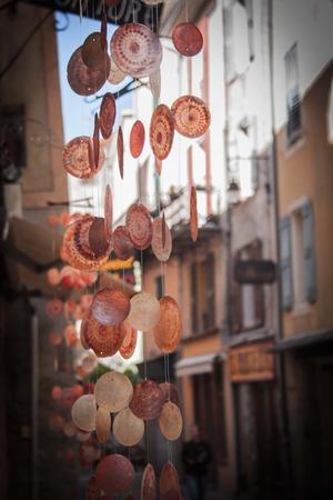 asian arowana: Chimes of mussels in a street in Castellane Stock Photo