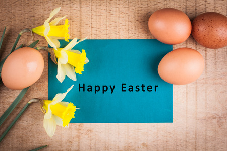 decode: Easter card with an inscription on a wooden background