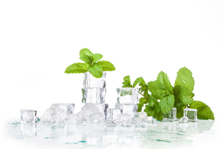 ice cubes and mint leaves isolated on a white background