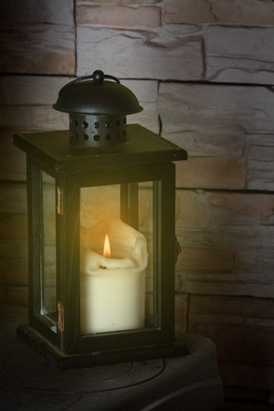 Christmas decoration lantern with burning candle