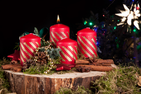 Advent wreath and candles on a Christmas background