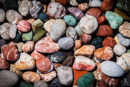 Colored pebbles on the beach and sea wave Stockfoto