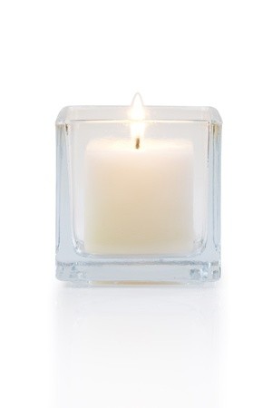 burning candle front view, isolated on white photo