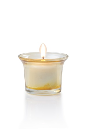 burning candle cut out on white background