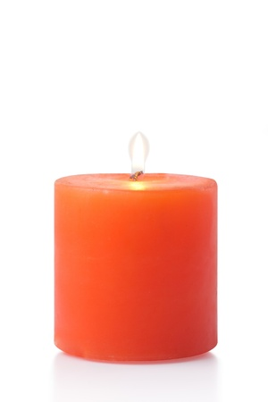 scented:  red candle on white background