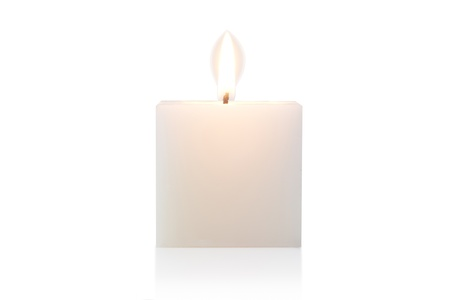 cubic burning candle, isolated on white photo