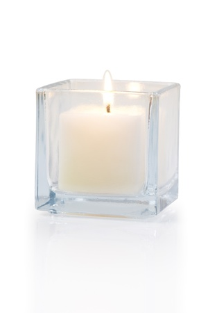 scented candle: burning candle side view 20 degree, on white background
