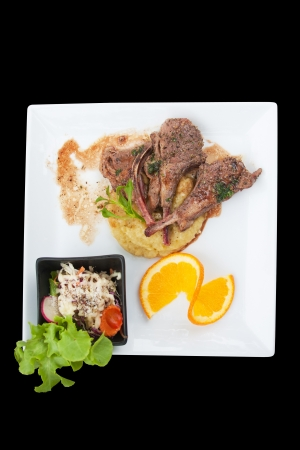 top view lamb steak isolated black photo