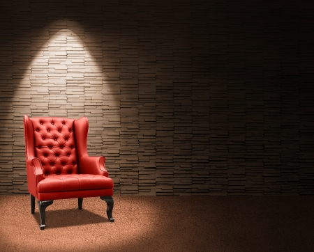 room with spotlight on red armchair.