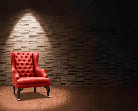 Zimmer mit Fokus auf roten Sessel. Lizenzfreie Bilder