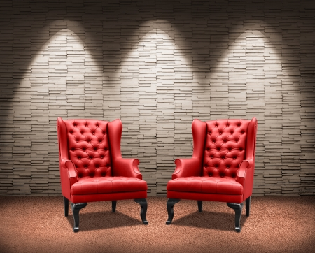 room with lighting on two red armchair. photo