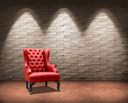 room with lighting on red armchair. Stock Photo