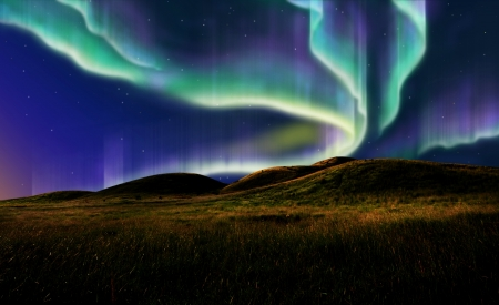 borealis: northern light on the silent field before sun rise. Stock Photo