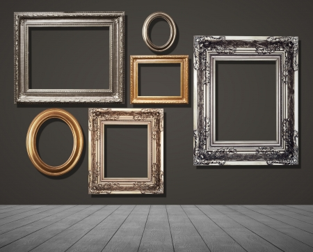 frames on black wall in room. photo